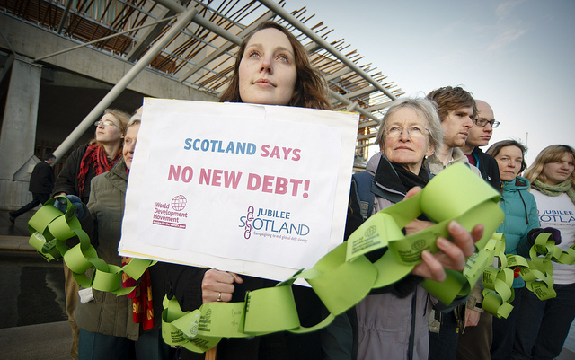 Campaigners protest for grants rather than loans in response to climate change