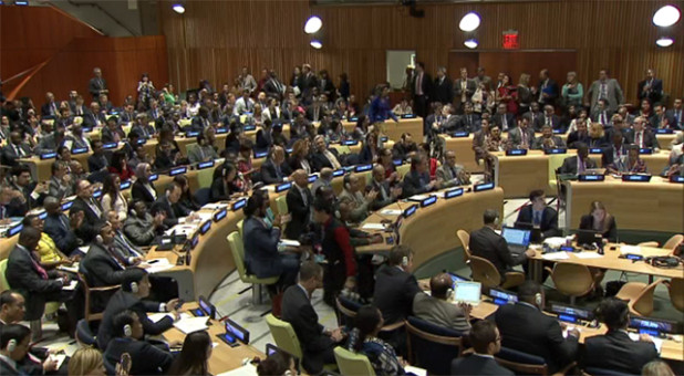 UN delegates applaud as the resolution passes at the General Assembly on 9 September.