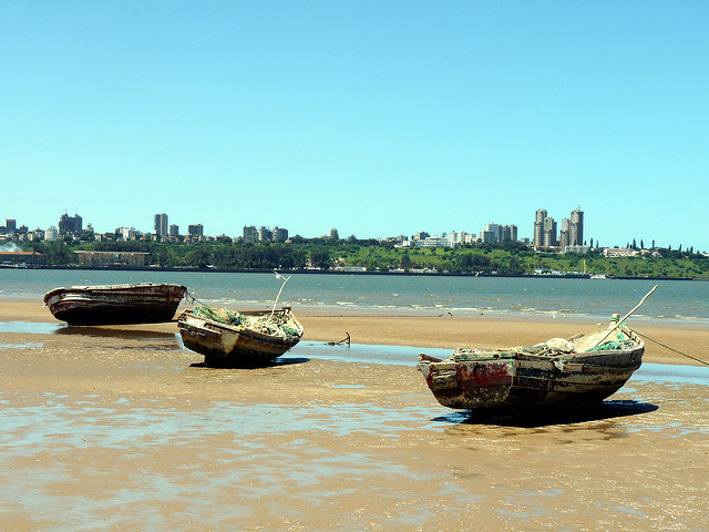 Small-scale traditional fishing boats in Maputo, capital of Mozambique, with the city rising behind (Cordelia Persen / Flickr)