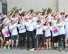 Team members do an 'Usain Bolt' prior to the Run