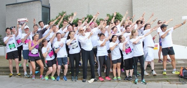 Team members do an 'Usain Bolt' prior to the Run