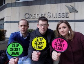 Campaigners from Jubilee Debt Campaign protesting against Credit Suisse's secret loans to Mozambique, outside their office in Canary Wharf, London