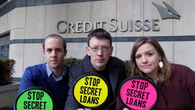 Campaigners from the Jubilee Debt Campaign protest outside the London office of Credit Suisse