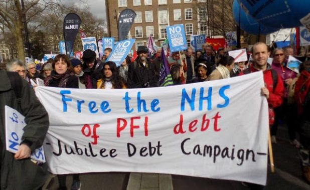 Jubilee Debt Campaign at #ourNHS march. Photo: Melanie Sirinathsingth