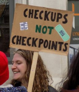 Some of the placcards on display at the #ourNHS march. Photo: Melanie Sirinathsingth