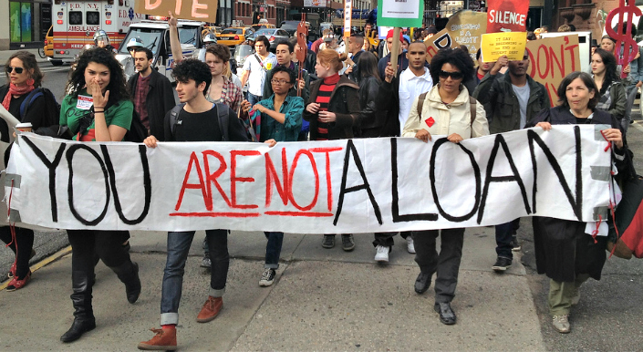 Students march with banner reading 'you are not a loan'